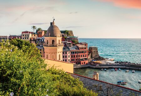 One of the five towns that make up the Cinque Terre region - Vernazza. Colorful spring morning in Liguria, Italy, Europe. Picturesqie seascape of Mediterranean sea. Traveling concept background. Stock fotó