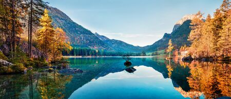 Fantastic autumn panorama on Hintersee lake. Colorful morning view of Bavarian Alps on the Austrian border, Germany, Europe. Beauty of nature concept background. Stok Fotoğraf