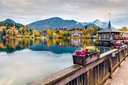 Captivating autumn sunrise on Grundlsee lake. Amazing morning scene of Brauhof village, Styria stare of Austria, Europe. Colorful view of Alps. Traveling concept background. Orton Effect.