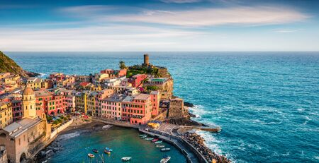 One of the five towns that make up the Cinque Terre region - Vernazza. Colorful spring morning in Liguria, Italy, Europe. Picturesqie seascape of Mediterranean sea. Traveling concept background. Фото со стока