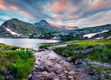 Fantastic summer sunset on Totensee lake. Beautiful evening scene of the top of Grimselpass, Swiss Alps, Canton of Bern, Switzerland, Europe. Beauty of nature concept background.