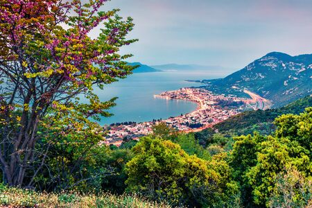 View from the birds-eye of Kamena Vourla town in the evening light. Colorful spring cityscape of Greece, Europe. Beautiful seascape of Aegean Sea. Traveling concept background.