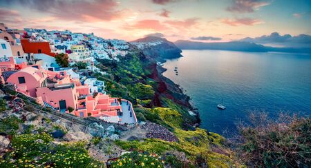 Unbelievable morning panorama of Santorini island. Picturesque spring sunrise of famous Greek resort Oia, Greece, Europe. Traveling concept background. Artistic style post processed photo.