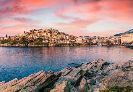 Fantastic spring seascape of Aegean Sea. Great sunrise in Kavala city, Macedonia, Greece, Europe. Traveling concept background. Artistic style post processed photo.