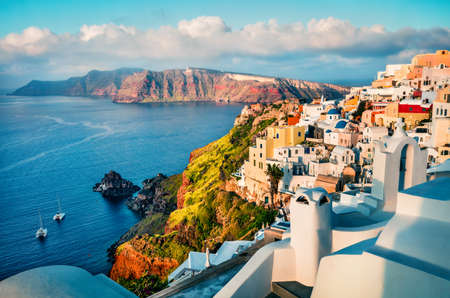 Colorful morning view of Santorini island. Picturesque spring sunrise on the famous Greek resort Oia, Greece, Europe. Traveling concept background. Artistic style post processed photo.