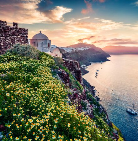 Fabulous morning view of Santorini island. Picturesque spring sunrise on  famous Greek resort Thira, Greece, Europe. Traveling concept background.