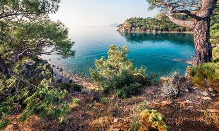 Attractive Mediterranean seascape in Turkey, Asia. Bright spring view of a small azure bay near the Tekirova village, District of Kemer, Antalya Province. Beauty of nature concept background. Stock Photo