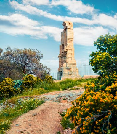 Great spring view of Monument of Philopappos. Colorful morning scene in Athens, Greece, Europe. Treveling concept background. Artistic style post processed photo. Stock Photo