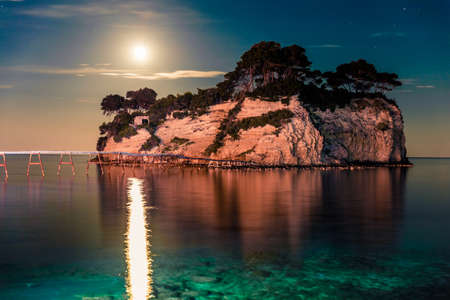 Fantastic night view of the Cameo Island. Slendid spring scene on the Port Sostis, Zakinthos island, Greece, Europe. Beauty of nature concept background.