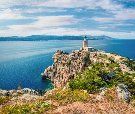 Bright sunny view of Melagavi lighthouse in the Corinth Gulf. Picturesque spring seascape in the Greece, Europe. Traveling concept background.