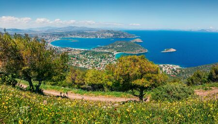 Aerial view of Porto Rafti town. Colorful spring seascape of Aegean sea. Sunny morning panorama of the Greece, Europe. Beauty of nature concept background.