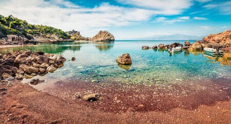 Bright summer panorama of Sterna Beach, popular tourist attraction, northeastern Corinthia, Greece. Sunny outdoor scene of the Greek resort. Beauty of nature concept background.