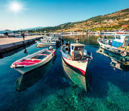 Sunny morning view of Agios Nikolaos, small port on the island of Zakynthos, Greece, Europe. Colorful summer seascape of Ionian sea. Traveling concept background.