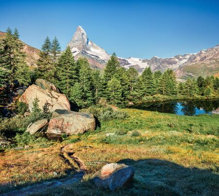 Fantastic summer morning on Grindjisee lake. Great view of Matterhorn (Monte Cervino, Mont Cervin) peak, Swiss Alps, Zermatt location, Valais canton, Switzerland, Europe.