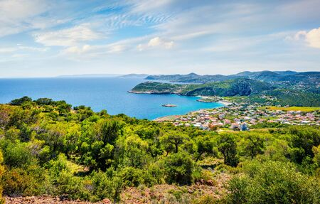 Aerial view of Paralia Kakis Thalassis village. Colorful spring seascape of Aegean sea. Sunny morning scene of the Greece, Europe. Beauty of nature concept background.