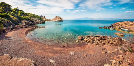 Colorful spring panorama on cozy beach in northeastern Corinthia, Greece. Sunny outdoor scene of the Greek resort. Beauty of nature concept background.