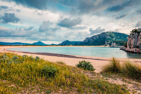 Colorful spring view of Voidokilia beach. Colorful sunset on the Ionian Sea, Pilos town location, Greece, Europe. Beauty of nature concept background.