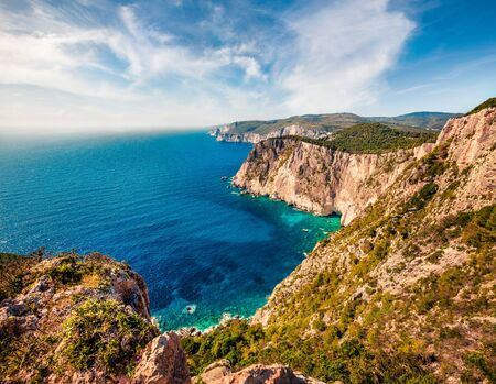 Aerial spring view of high cliffs on the Ionian Sea. Sunny morning seascape of Zakynthos (Zante) island, Greece, Europe. Beauty of nature concept background.