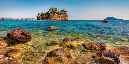 Sunny spring panorama of Cameo Island. Beautiful morning scene of Port Sostis, Zakinthos island, Greece, Europe. Beauty of nature concept background.