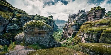 Green spring panorama of Meteora. Great morning view of Eastern Orthodox monasteries, built on top of rock pillars. Kalambaka village location, Greece, Europe. Zdjęcie Seryjne