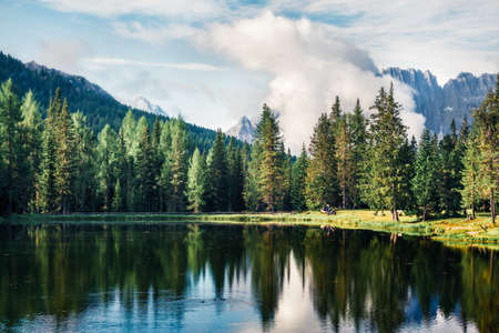 Foggy morning view of Antorno lake with Cristallo mountain range on background. Picturesque autumn scene of Dolomite Alps, Province of Belluno, Italy, Europe.