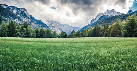 Dramatic summer panorama of Triglav mountain range. Gloomy mporinng view of Julian Alps, Slovenia. Beauty of nature concept background. Zdjęcie Seryjne