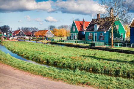 Tipical Dutch buildings in Zaanstad village. Sunny spring view of Netherlands countryside. Bright morning scene in Holland, Europe. Traveling concept background. Zdjęcie Seryjne