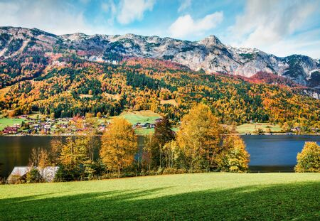Sunny autumn view of Grundlsee lake. Amazing morning scene of Brauhof village, Styria stare of Austria, Europe. Colorful view of Alps. Traveling concept background.