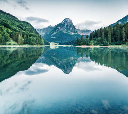 Spectacular summer scene of Swiss lake - Obersee, located near Nafels village. Dramatic morning view of Alps mountains, Switzerland, Europe.