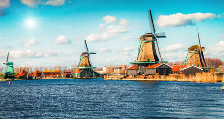 Famous windmills. Sunny spring morning in countryside. Colorful outdoor scene in Netherlands, Europe.