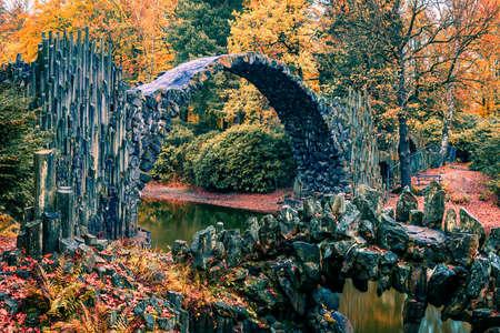 Fantastic morning view of Azalea and Rhododendron Park Kromlau, Germany, Europe. Splendid autumn scene of Rakotz Bridge (Rakotzbrucke, Devil's Bridge). Traveling concept background. Zdjęcie Seryjne