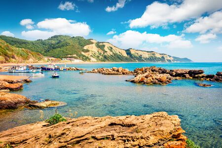Sunny spring view of small port in Gardenos village. Picturesque morning seascape of Ionian Sea. Splendid landscape of Corfu island, Greece, Europe. Traveling concept background.