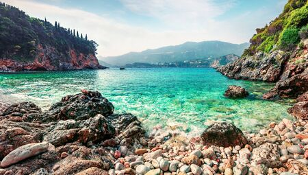 Wonderful spring view of Limni Beach Glyko. Colorful morning seascape of Ionian Sea. Picturesque outdoor scene of Corfu island, Greece, Europe. Beauty of nature concept background.