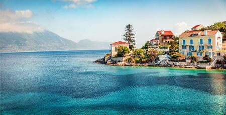 Amazing spring view of port Fiskardo. Picturesque morning seascape of Ionian Sea. Stunning outdoor scene of Kefalonia island, Greece, Europe. Traveling concept background.