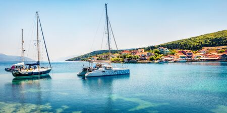 Great panoramic view of Fiskardo port. Splendid spring seascape of Ionian Sea. Colorful morning scene of Kefalonia island, Greece, Europe. Traveling concept background.