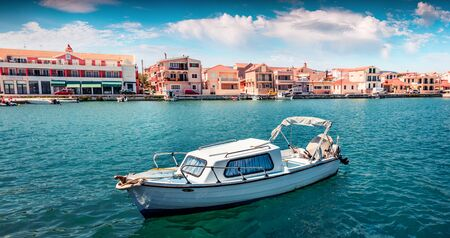 Panoramic morning view of Lixouri port. Colorful spring seascape of Ionian Sea. Picturesque outdoor scene of Cephalonia island. Traveling concept background.