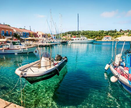 Wonderful spring view of port Fiskardo. Picturesque morning seascape of Ionian Sea. Stunning outdoor scene of Kefalonia island, Greece, Europe. Traveling concept background. Stock Photo