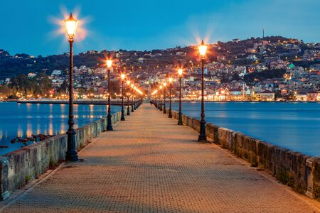 Fabulous evening cityscape of Argostolion town, former municipality on the island of Kefalonia, Ionian Islands, Greece. Gorgeous spring seascape of Ionian Sea. Traveling concept background.