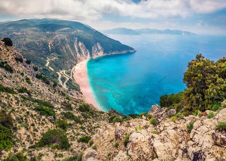 Aerial view of Myrtos bay. Misty morning scene of Cephalonia island, Divarata village location, Greece, Europe. Fantastic spring seascape of Ionian Sea. Beauty of nature concept background.