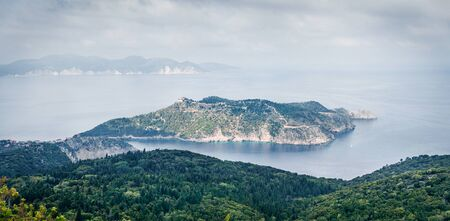 Aerial spring view of Asos peninsula and town. Misty morning seascape of Ionian Sea. Majestic outdoor scene of Kephalonia island, Greece, Europe. Traveling concept background.