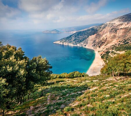 Aerial view of Myrtos bay. Splendid morning scene of Cephalonia island, Divarata village location, Greece, Europe. Spectacular spring seascape of Ionian Sea. Beauty of nature concept background.