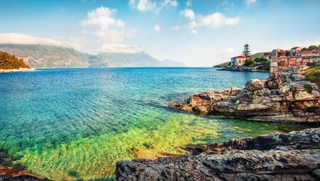 Incredible spring view of port Fiskardo. Picturesque morning seascape of Ionian Sea. Stunning outdoor scene of Kefalonia island, Greece, Europe. Traveling concept background. Stock Photo