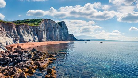 Picturesque spring landscape of famous Xi Beach. Sunny morning scene of Cephalonia island, Greece, Europe. Attractive seascape of Ionian Sea. Traveling concept background.