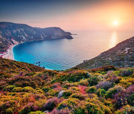 Unbelievable spring view of Petani Beach. Great sunset on Cephalonia Island, Greece, Europe. Beautiful evening seascape of Mediterranen Sea. Fantastic outdoor scene of Ionian Islands.