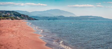 Panoramic spring view of Megas Lakkos Beach. Sunny morning scene of Cephalonia island, Greece, Europe. Attractive seascape of Ionian Sea. Traveling concept background.