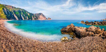 Panoramic spring view of famous Petani Beach. Splendid morning scene of Cephalonia Island, Greece, Europe. Fantastic seascape of Mediterranen Sea. Stunning outdoor scene of Ionian Islands. Stock Photo