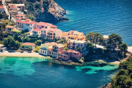 Aerial view of the Asos village from the Venetian Castle Ruins. Sunny spring seascape of Ionian Sea. Splendid outdoor scene of Kefalonia island, Greece, Europe. Traveling concept background.