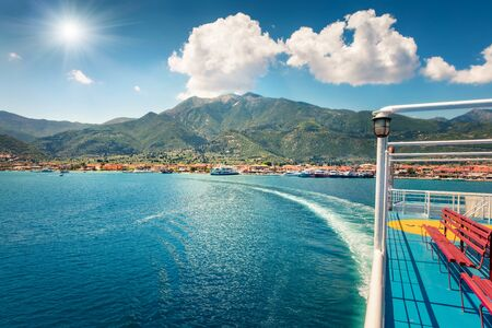 Treveling by ferry from Lefkada island to Kefalonia. Sunny morning seascape of Ionian Sea. Colorful spring view of Nydri town, Greece, Europe. Traveling concept background.