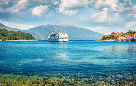 Beautiful spring view of port Fiskardo. Splendid morning seascape of Ionian Sea. Panoramic outdoor scene of Kefalonia island, Greece, Europe. Traveling concept background.