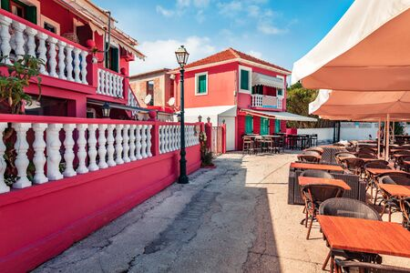 Spectacular spring cityscape of Fiskardo town, Ionian Island. Colorful outdoor scene of Kefalonia island, Greece, Europe. Traveling concept background.
